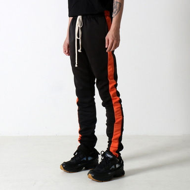 [$ SHOP SALE] [EPTM] TECHNO TRACK PANTS (BLACK/ORANGE)