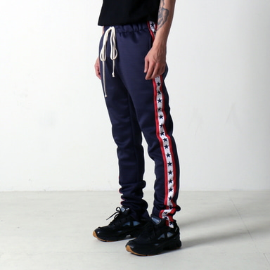 [쿠드그라스 연말 FINAL SALE] [EPTM] GRAPHIC TRACK PANTS (NAVY STARS)